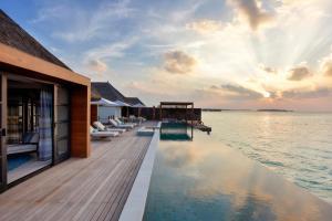 The swimming pool at or near Four Seasons Resort Maldives at Kuda Huraa