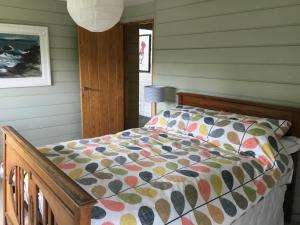 A bed or beds in a room at Potato, Barafundle Barns, SA71 5LS