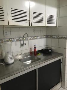 A kitchen or kitchenette at Flat Hostolla Marssielle
