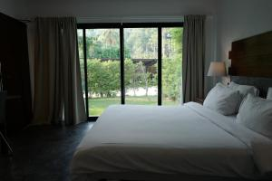 A bed or beds in a room at Nature Beach Resort