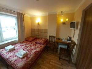 Łóżko lub łóżka w pokoju w obiekcie Willa Muza