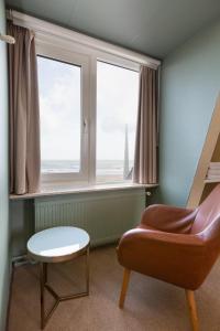 A seating area at Strandhotel Scheveningen