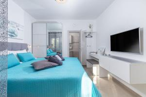A bed or beds in a room at eVita Fazana Premium Studio Apartments
