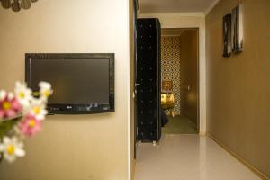 A television and/or entertainment center at Weekend Boutique Hotel