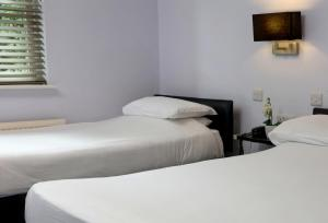 A bed or beds in a room at Sure Hotel by Best Western Reading