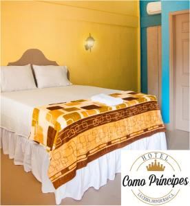 A bed or beds in a room at Hotel Como Principes