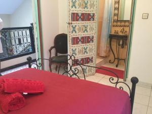 A bed or beds in a room at RIAD 131