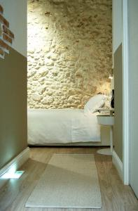 A bed or beds in a room at Via Garibaldi 120