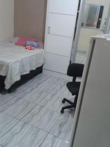 A bed or beds in a room at Sentir Bem