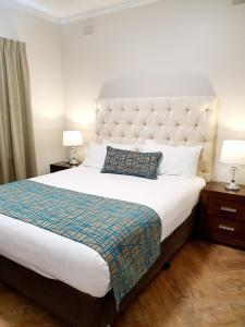A bed or beds in a room at Largs Pier Hotel