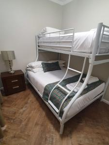 A bunk bed or bunk beds in a room at Largs Pier Hotel
