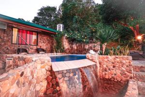 The swimming pool at or near El Nido Viewdeck Cottages