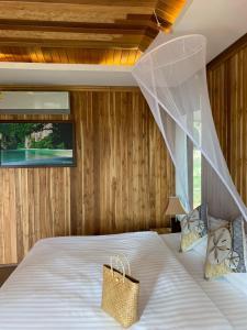 Voodi või voodid majutusasutuse Thiwson Beach Resort toas