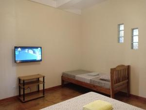 A bed or beds in a room at Villa Skanderbeg Guest House