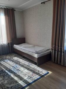 Кровать или кровати в номере Yurt camp Meiman Ordo