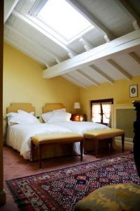 Letto o letti in una camera di La Torre Dei Canonici