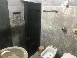 Um banheiro em Albergo Alegria