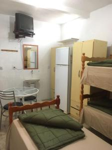 A bunk bed or bunk beds in a room at Pousada Agronomia