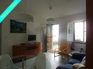 A television and/or entertainment center at Casa do Briamante 9