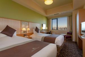 ホテルモントレ グラスミア大阪にあるベッド