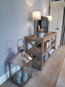 Een zitgedeelte bij charming holiday home casa-cosi, with private swimmingpool and sauna