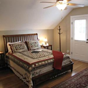 A bed or beds in a room at Brickhouse Inn B&B