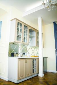 Кухня или мини-кухня в Gosudar Hotel