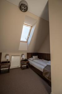 A bed or beds in a room at Villa Meribel