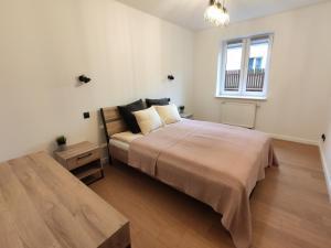 Postel nebo postele na pokoji v ubytování Green Warsaw Apartment