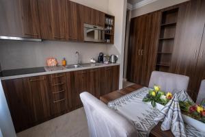 A kitchen or kitchenette at Villa Meribel