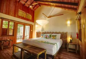 A bed or beds in a room at Jungle Bay Dominica