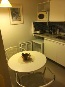 A kitchen or kitchenette at Manawa Beach Flats Prime