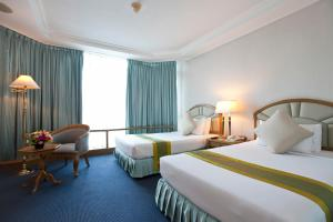 A bed or beds in a room at Windsor Suites Bangkok, Managed by Accor