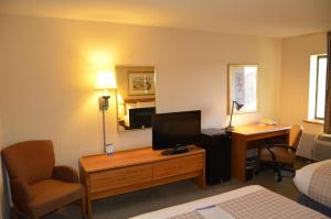 A television and/or entertainment center at Baymont by Wyndham Davenport