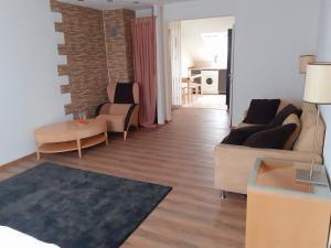 Ein Sitzbereich in der Unterkunft Apartment City Metzingen