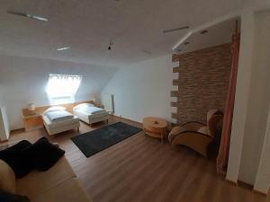 Ein Bett oder Betten in einem Zimmer der Unterkunft Apartment City Metzingen