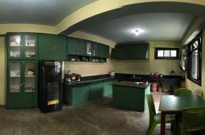 A kitchen or kitchenette at La Bougainvillea Retreat