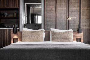 A bed or beds in a room at Domes Zeen Chania, a Luxury Collection Resort, Crete