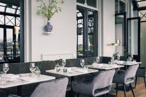 A restaurant or other place to eat at Pillows Luxury Boutique Hotel Aan De IJssel