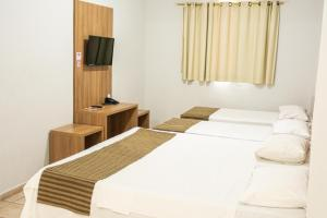 A bed or beds in a room at Abudi Hotel