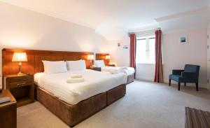 A bed or beds in a room at Schull Harbour Hotel & Leisure Centre