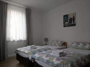 A bed or beds in a room at Ferienwohnung Paradiesle