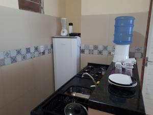 A kitchen or kitchenette at Chalés Canto do Mar
