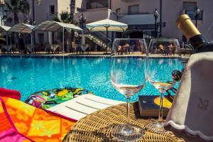 The swimming pool at or near Hotel Sirenetta