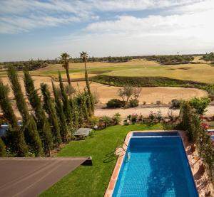 A view of the pool at Villa en 1ere ligne du Golf Palm Ourika or nearby