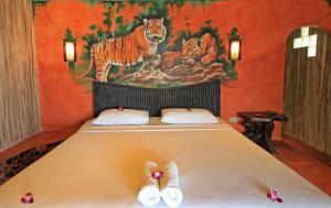 Säng eller sängar i ett rum på Cactus Bungalow