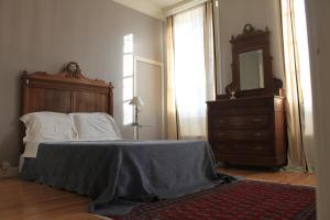 A bed or beds in a room at B&B Coup de Coeur
