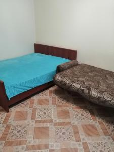 Кровать или кровати в номере Apartment in 14 Microdistrict