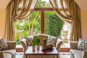 A seating area at Mitsis Ramira Beach Hotel