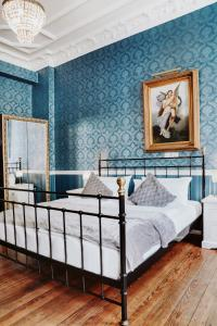 A bed or beds in a room at Honigmond Boutique Hotel